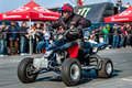 Moto stunt-riding quad bike Royalty Free Stock Photo