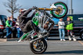 Moto stunt-riding wheelie Stock Image