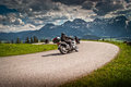 Motobikes motorbikes on the road in mountains with alps in background salzkamm ergut austria Stock Image