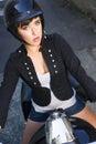 Motocicleta rider attractive female leaves garage en el callejón trasero Fotos de archivo libres de regalías