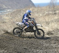 Motocross bike in a race representing concept of speed and power extreme man sport Royalty Free Stock Photo