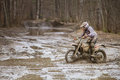 Motocross challenge driver on wet and muddy terrain in finland Royalty Free Stock Images