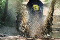Motocross crossing creek, water splashing. Royalty Free Stock Photo