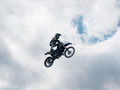 Motocross freestyle rider Stay On Seat jump Royalty Free Stock Photo