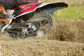 Motocross racer accelerating speed in track Royalty Free Stock Photo
