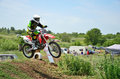 Motocross racer performs a jump efficient Royalty Free Stock Photos
