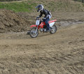 Motocross Racer Riding on a Dirt Track Stock Photo