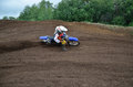 Motocross racer veering with large slope Royalty Free Stock Photos