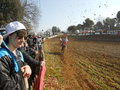 Motocross racing onlookers enjoy a mudy race in france Stock Photo