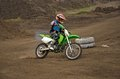 Motocross rider girl on a bend of the track MX Royalty Free Stock Photo