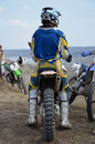 Motocross rider in the helmet on a motorcycle Royalty Free Stock Photo