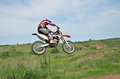 Motocross rider on a motorcycle in a jump Stock Photo