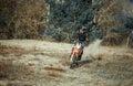 Motocross rider ride dirt bike on sand in small desert Stock Photography