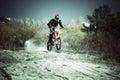 Motocross rider ride dirt bike on sand in small desert Stock Image