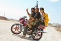 Motocycle rebels azaz syria three motorcycle mounted members of the free syrian army on the road into Royalty Free Stock Photography