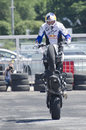 Motor bike acrobatics freestyle stunt rider and times world champion chris pfeiffer engaged in a demonstration during the Royalty Free Stock Image