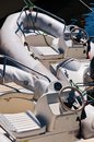 Motor boat two inflatable moored on the berth closeup Royalty Free Stock Photography