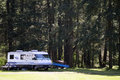 Motor home vintage car boats and on a trailer in a forest campgrounds in tacoma washington on mccord airfield Stock Images