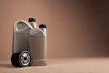 Motor oil containers on brown background Royalty Free Stock Photos