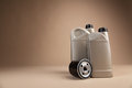 Motor oil containers on brown background Stock Photo