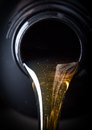 Motor oil pouring over black background Stock Image