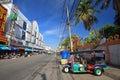 Motor tricycle called tuk tuk parking korat apr opposite local fresh market in nakhon ratchasima aka korat thailand on april Stock Photos