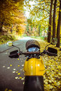 Motorbike adventure road view with autumn scenery Royalty Free Stock Image
