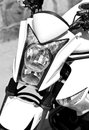 Motorbike close up a of a front and the headlight of a Stock Images