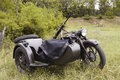 Motorbike with a machine gun old fashioned soviet motorcycle sidecar since the second world war mounted Royalty Free Stock Photos