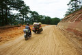 Motorbike people transport goods by on marshy road in dalat viet nam september Stock Photo