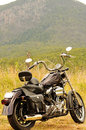 A motorbike on a road trip summer holiday touring outback Australia Royalty Free Stock Photo