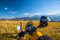 Motorbike travel in mountains an yellow adventure with panorama view during autumn season Stock Photo