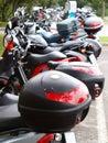 Motorbikes parking Royalty Free Stock Photo
