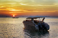 Motorboat at sunset beautiful landscape Stock Photos