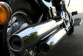 Motorcycle chrome exhaust close up of a Stock Photo