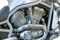 Motorcycle chrome metal grille side view of a custom engine Stock Images