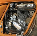 Motorcycle engine close up with orange frame and rustiness Royalty Free Stock Images
