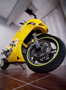 Motorcycle in garage big yellow powerful Royalty Free Stock Image