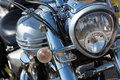 Motorcycle headlight closeup of chromed Royalty Free Stock Photos
