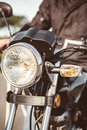 Motorcycle headlights with senior man steering Royalty Free Stock Photo
