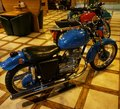 Motorcycle `Java`, which is an undefined element of the design of a pub or bar