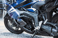Motorcycle luxury items close-up: headlights, shock absorber, wheel, wing, toning. Royalty Free Stock Photo