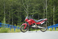 Motorcycle on a mountain road in the forest Stock Photography