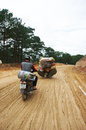 Motorcycle people transport goods by on marshy road in dalat viet nam september Royalty Free Stock Image