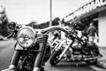 Motorcycle profile with handlebars and headlight a black white photo of a parked a shallow depth of field features nacelle in Royalty Free Stock Images