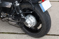 Motorcycle rear wheel and exhaust pipe Stock Image