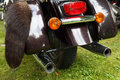 Motorcycle rear wheel and exhaust pipe Royalty Free Stock Photos