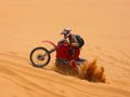 Motorcycle rider burying back wheel under sand simpson desert australia Royalty Free Stock Photo