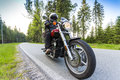 Motorcycle rider driving through forest Royalty Free Stock Photo