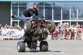 A motorcycle rider make wheelie on the ATV